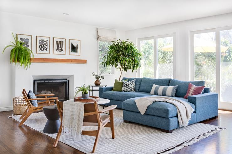 Blue Sofa With Chaise Lounge On Gray Fringe Rug - Transitional - Living Room