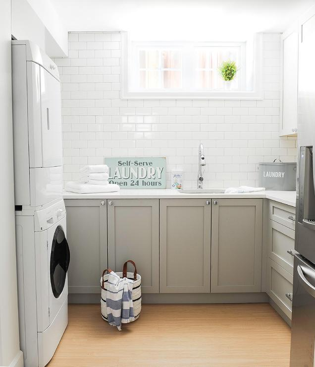 White And Gray Laundry Room In Basement Transitional Laundry Room