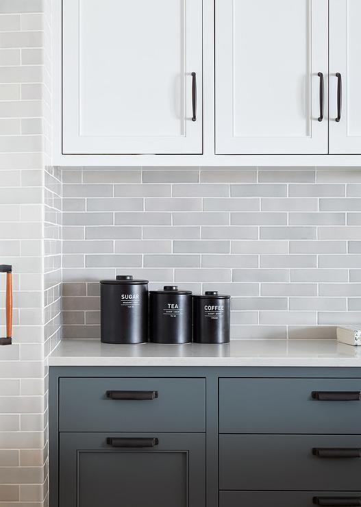 Light Gray Staggered Tiles With White And Gray Cabinetry Transitional Kitchen