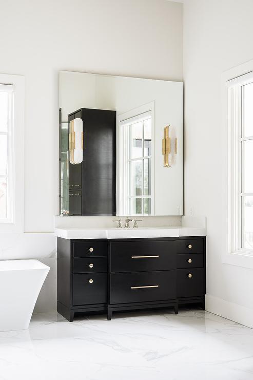 Marble And Brass Sconces On Frameless Beveled Vanity Mirror Modern Bathroom