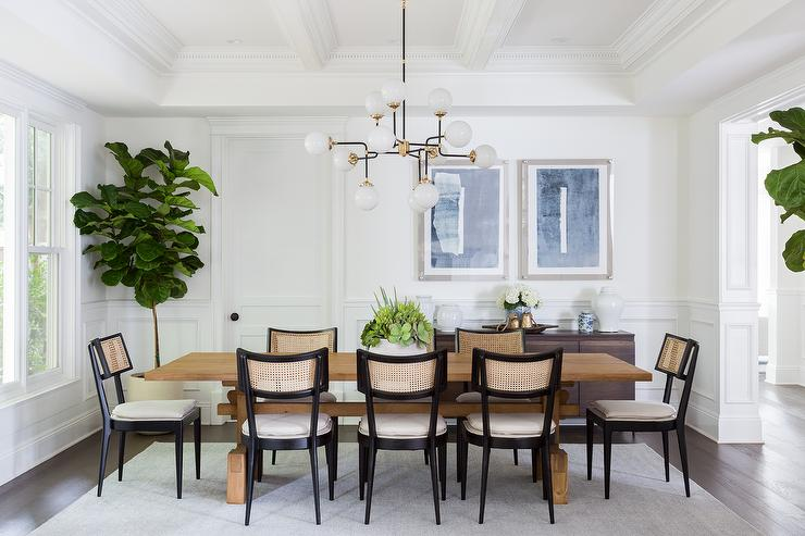 Vintage Black Cane Chairs At Reclaimed Wood Dining Table Transitional Dining Room